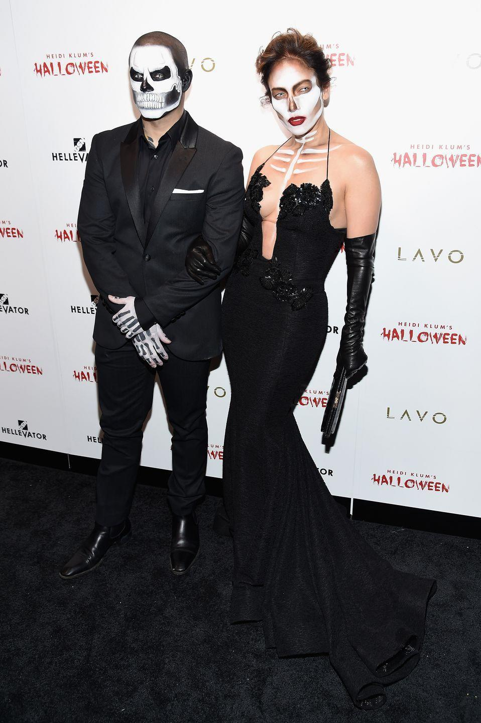 <p>The actress and Casper Smart wore all black formalwear paired with elaborate face makeup for an unforgettable Halloween look. This is what we call spooky chic.</p>