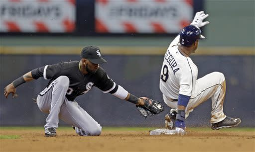Milwaukee Brewers' Jean Segura (9) steals second base as Chicago White Sox's Alejandro De Aza applies the late tag during the second inning of an exhibition baseball game Saturday, March 30, 2013, in Milwaukee. (AP Photo/Jeffrey Phelps)