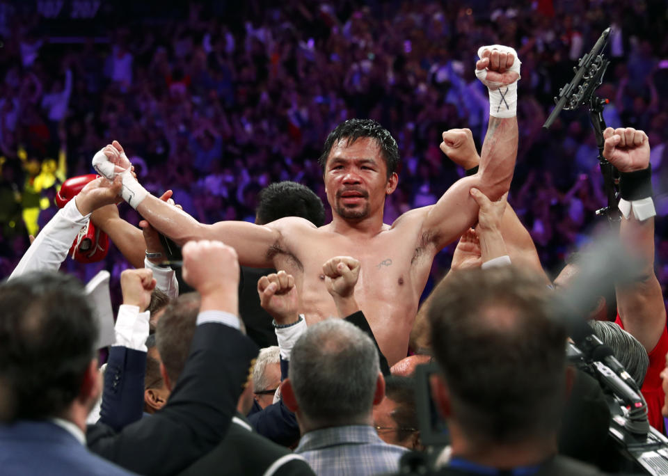 FILE PHOTO:  Manny Pacquiao celebrates his split decision victory over Keith Thurman in their WBA welterweight title fight at MGM Grand Garden Arena on July 20, 2019 in Las Vegas, Nevada.  (Photo by Steve Marcus/Getty Images)