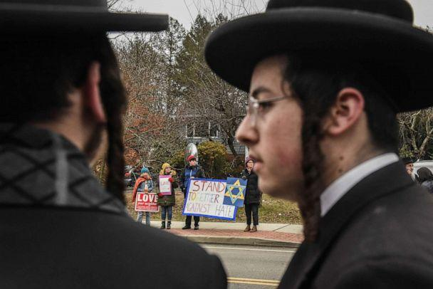 PHOTO: People hold signs of support near the house of Rabbi Chaim Rottenberg on Dec. 29, 2019, in Monsey, New York. (Stephanie Keith/Getty Images)