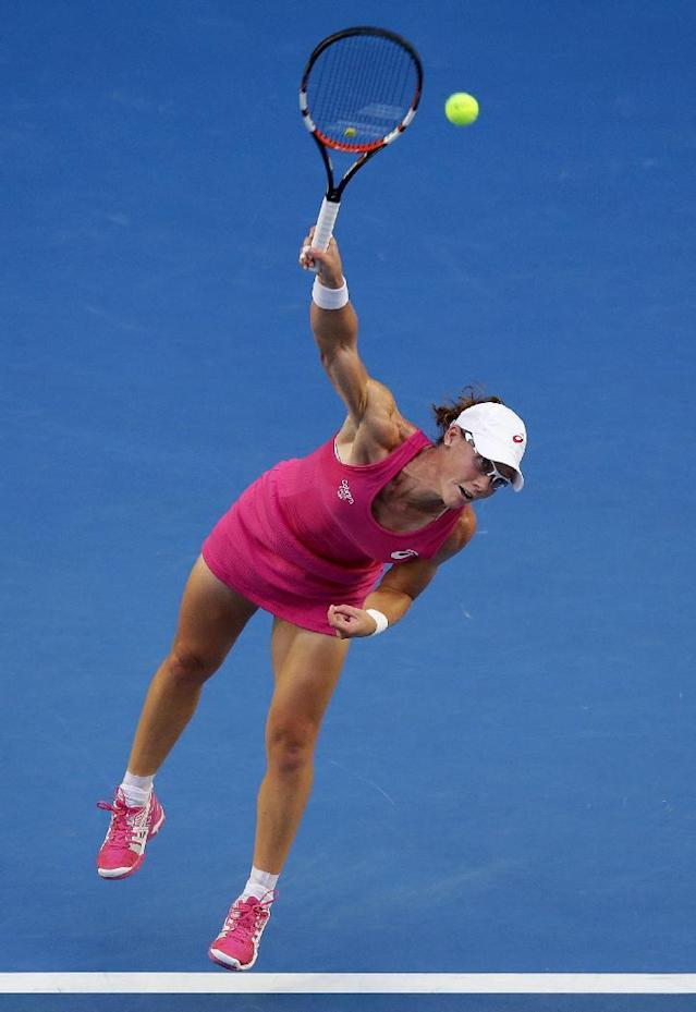 Samantha Stosur of Australia serves to Tsvetana Pironkova of Bulgaria during their second round match at the Australian Open tennis championship in Melbourne, Australia, Wednesday, Jan. 15, 2014.(AP Photo/Aaron Favila)