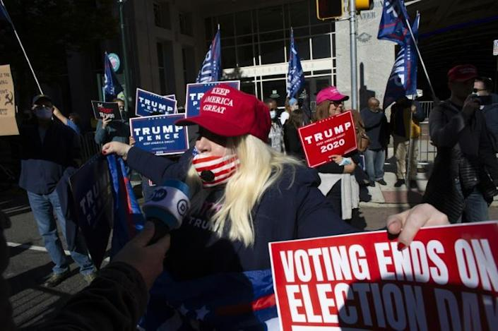 Donald Trump supporters gather in front of Pennsylvania's Convention Center, where vote tallying continues