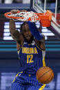 Indiana Pacers' Oshae Brissett dunks during the second half of the team's NBA basketball Eastern Conference play-in game against the Charlotte Hornets, Tuesday, May 18, 2021, in Indianapolis. (AP Photo/Darron Cummings)