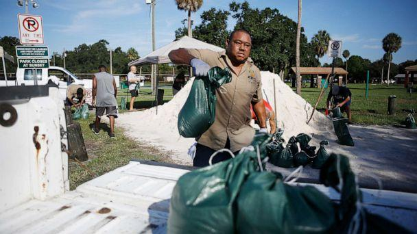 PHOTO: City of Tampa Parks & Recreation employee Rod McKinney helps Horace Whittington 61, of Tampa load sandbags in his truck for his mother 91-year-old mother in preparation for Hurricane Dorian at MacFarlane Park in Tampa, Fla., Aug. 29, 2019. (Octavio Jones/Tampa Bay Times via ZUMA Press)