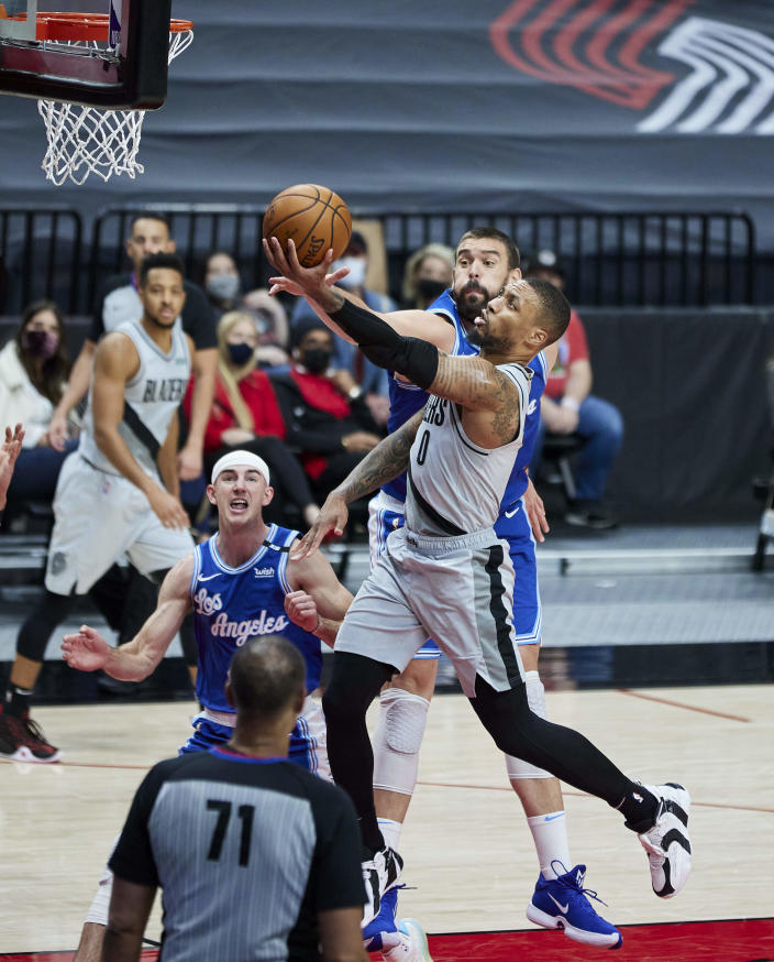 Portland Trail Blazers guard Damian Lillard (0) shoots over Los Angeles Lakers center Marc Gasol during the second half of an NBA basketball game in Portland, Ore., Friday, May 7, 2021. (AP Photo/Craig Mitchelldyer)