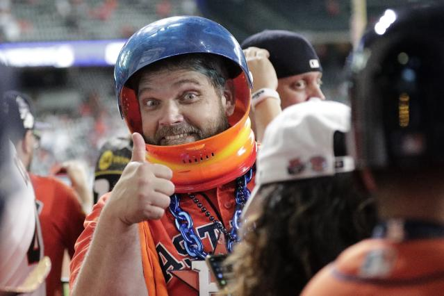 A Houston Astros fan gives a thumbs up before Game 1 of the baseball World Series against the Washington Nationals Tuesday, Oct. 22, 2019, in Houston. (AP Photo/David J. Phillip)