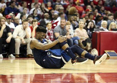 Feb 23, 2018; Houston, TX, USA; Minnesota Timberwolves guard Jimmy Butler (23) reacts after an apparent injury during the third quarter against the Houston Rockets at Toyota Center. Mandatory Credit: Troy Taormina-USA TODAY Sports