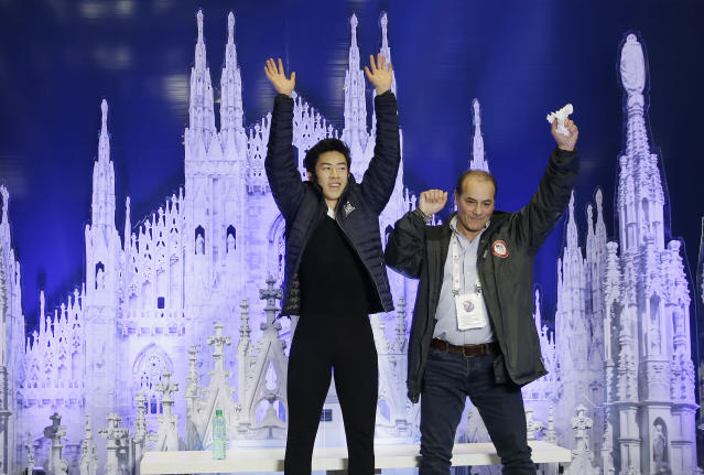 United States' Nathan Chen, left, celebrates with his coach after winning a men's competition at the Figure Skating World Championships in Assago, near Milan, Saturday, March 24, 2018. (AP Photo/Luca Bruno)