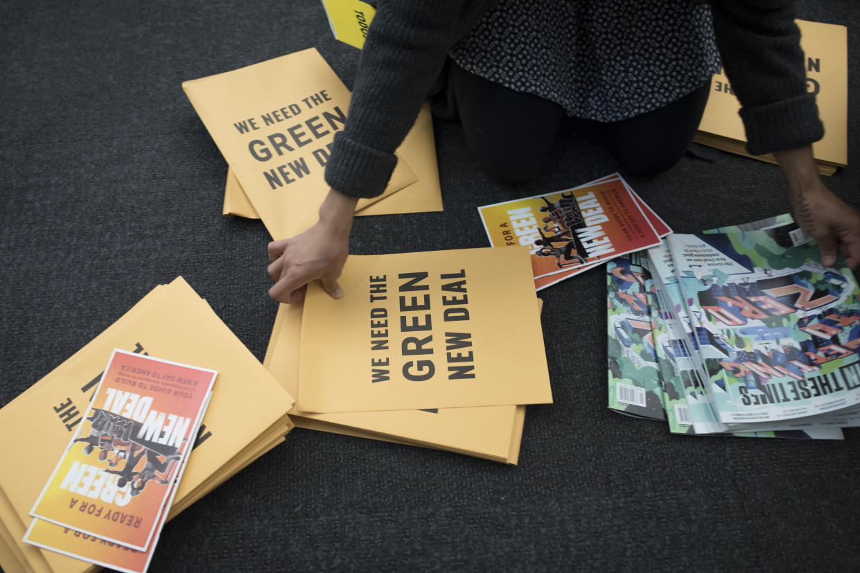 A volunteer prepares information packets for a Green New Deal event in Washington, D.C., last month. (Photo: Cliff Owen/AP)
