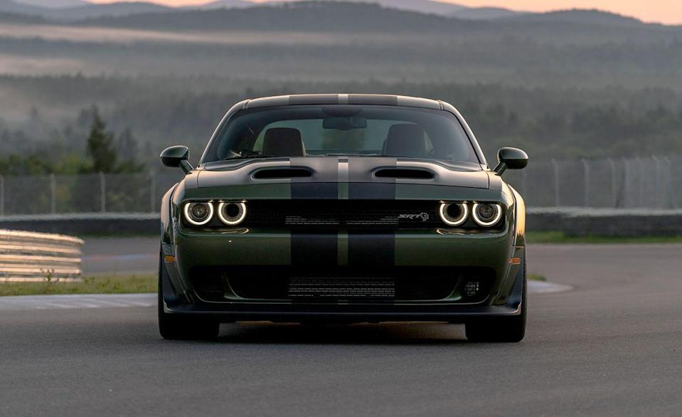 """<p>Like its rivals the Ford Mustang and the Chevy Camaro, the <a href=""""https://www.caranddriver.com/dodge/challenger"""" rel=""""nofollow noopener"""" target=""""_blank"""" data-ylk=""""slk:Dodge Challenger"""" class=""""link rapid-noclick-resp"""">Dodge Challenger</a> is still offered with a manual gearbox. In fact, the Dodge is the only model Fiat Chrysler offers in the U.S. with a stick. Several versions of Mopar's muscle car come standard with a six-speed manual, including the R/T, R/T Scat Pack, the supercharged 700-plus-hp Hellcat and the Hellcat Widebody.</p>"""