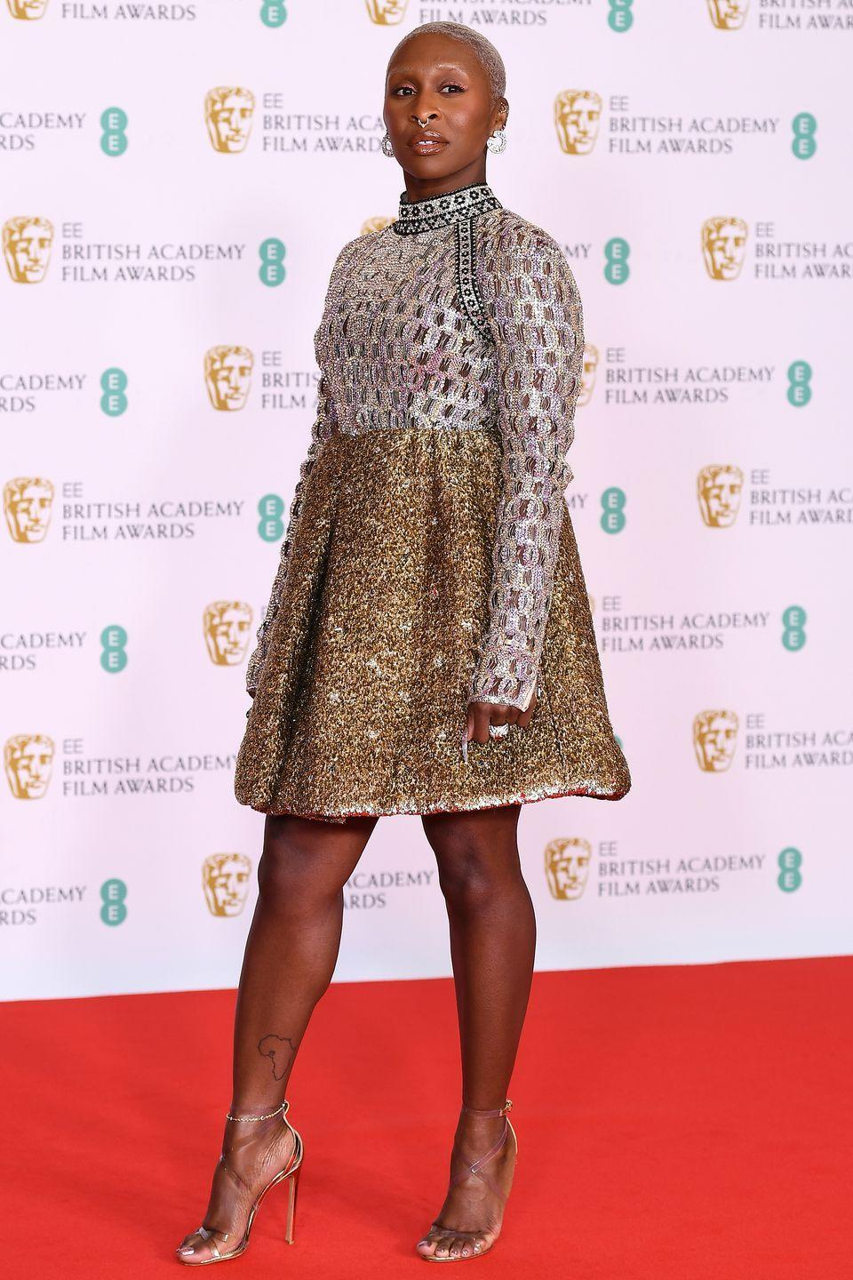 <p>Cynthia Erivo made a statement in a silver and gold Louis Vuitton dress and strappy matching heels.</p>