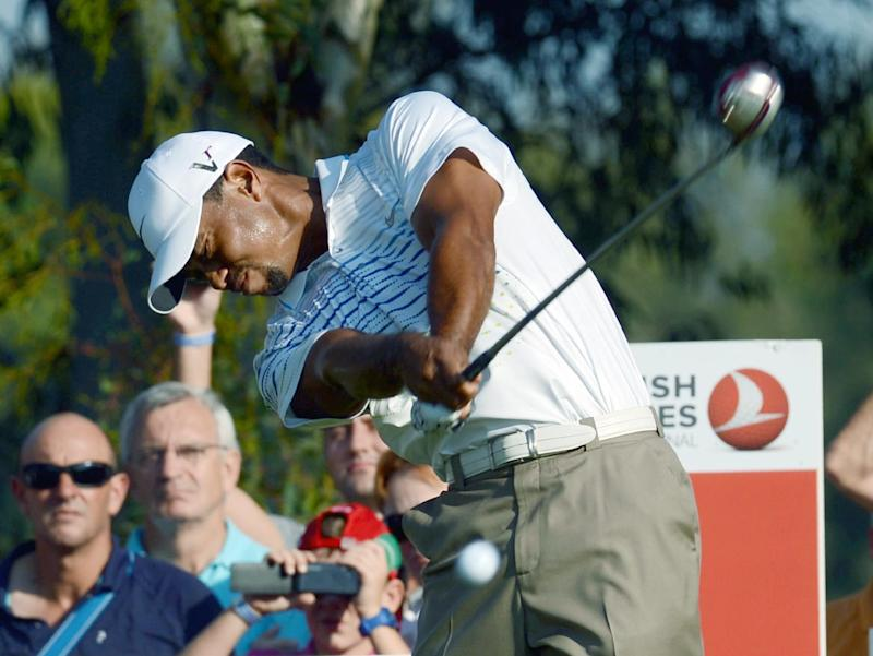 USA's Tiger Woods plays a tee-shot during his World Golf Final Group 1 match against Rory McIlroy of Northern Ireland  in Belek, Antalya, Turkey, Thursday, Oct. 11, 2012. (AP Photo)