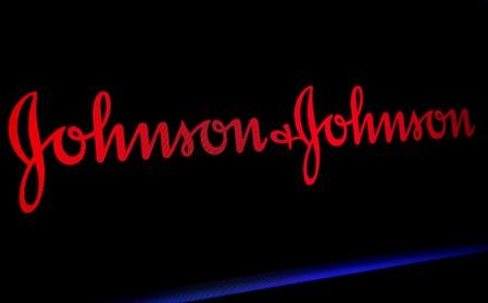 FILE PHOTO: The Johnson & Johnson logo is displayed on a screen on the floor of the NYSE in New York