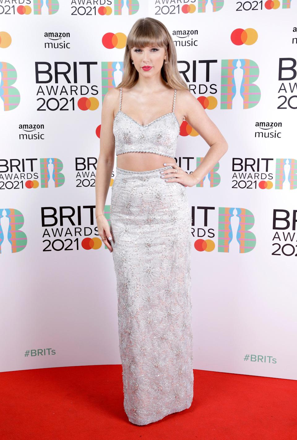 """<h2>Taylor Swift in Miu Miu</h2><br>Taylor Swift is the queen of two-piece red carpet looks.<span class=""""copyright"""">Photo: JMEnternational/JMEnternational for BRIT Awards/Getty Images.</span>"""