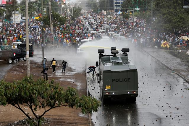 <p>Policemen spray water to disperse supporters of Kenyan opposition leader Raila Odinga in Nairobi, Kenya, Nov. 17, 2017. (Photo: Thomas Mukoya/Reuters) </p>