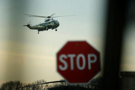 U.S. President Donald Trump arrives aboard the Marine One to greet the remains of a U.S. military commando killed during a raid on the al Qaeda militant group in southern Yemen on Sunday, at Dover Air Force Base, Dover, Delaware, U.S. February 1, 2017. (Note: photograph was made from the interior of a media vehicle.) REUTERS/Jonathan Ernst