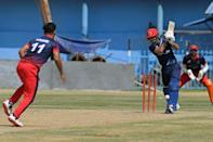 A batsman for eventual winners Peace Defenders plays a shot during the Twenty20 cricket match (AFP/Aamir QURESHI)
