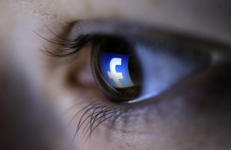 A picture illustration shows a Facebook logo reflected in a person's eye, in Zenica, March 13, 2015. Facebook Inc recorded a slight increase in government requests for account data in the second half of 2014, according to its Global Government Requests Report, which includes information about content removal.Requests for account data increased to 35,051 in the second half of 2014 from 34,946 in the first half, with requests from countries such as India rising and those from others including United States and Germany falling, the report by the world's largest Internet social network showed. Facebook said it restricted 9,707 pieces of content for violating local laws, 11 percent more than in the first half, with access restricted to 5,832 pieces in India and 3,624 in Turkey. Picture taken on March 13. REUTERS/Dado Ruvic (BOSNIA AND HERZEGOVINA - Tags: SOCIETY PORTRAIT SCIENCE TECHNOLOGY BUSINESS TELECOMS TPX IMAGES OF THE DAY)