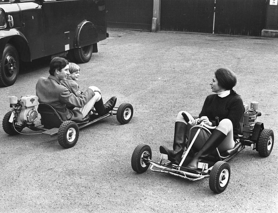<p>Riding motorized go-karts with her brothers.</p>