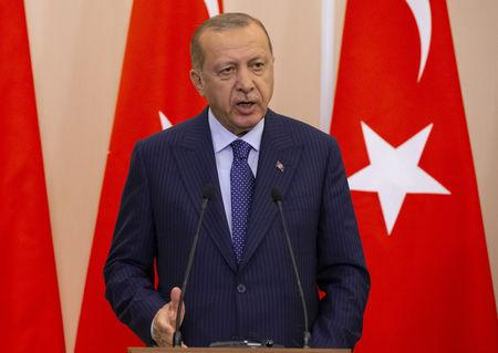 FILE PHOTO: Turkish President Erdogan speaks during a news conference