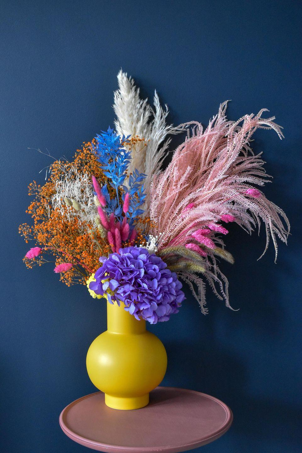 """<p>Dried flowers may conjure up memories of potpourri – but the latest incarnation is very de rigueur. Think pink ornamental grass, coral gypsophila, red eucalyptus and yellow hydrangea – eclectic arrangements in upbeat tones. Preserved using an eco-friendly process, these can be admired for up to one year. From £39, <a href=""""https://www.appreciationproject.co.uk/collections/all-dried-flowers-vases?gclid=EAIaIQobChMIyLvggoKm7wIVB9myCh1Plg6vEAAYASAAEgIX9vD_BwE"""" rel=""""nofollow noopener"""" target=""""_blank"""" data-ylk=""""slk:appreciationproject.co.uk"""" class=""""link rapid-noclick-resp"""">appreciationproject.co.uk</a></p>"""