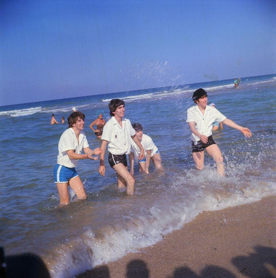 <p>The Beatles splash onlookers at Miami Beach, Florida, in 1964. </p>
