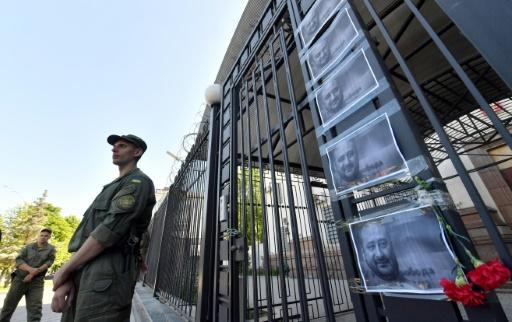 Flowers and pictures of anti-Kremlin journalist Arkadi Babchenko were left at the Russian embassy in Kiev after his reported death -- which Ukraine has since admitted was faked