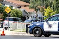 Emergency responders tend to a fire at the house of the suspected San Jose, California shooter on May 26, 2021