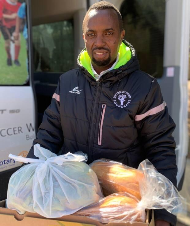 After starting with a soccer program, Jean Claude Munyezamu has expanded the work he does with Umoja Community Mosaic to meet a number of needs, including support for those struggling with food insecurity.