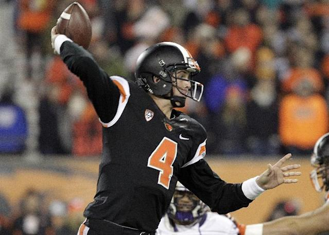 Oregon State quarterback Sean Mannion passes during the first half of an NCAA college football game against Washington in Corvallis, Ore., Saturday, Nov. 23, 2013. (AP Photo/Don Ryan)