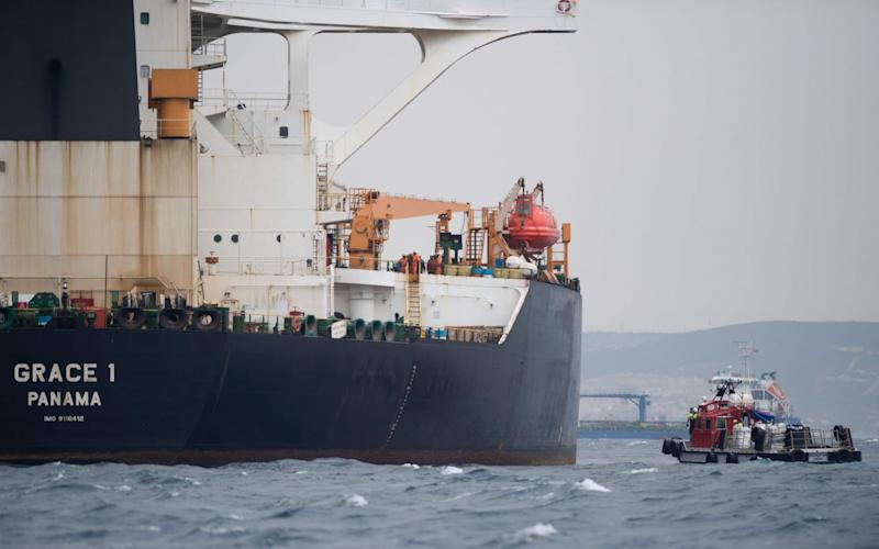 A ship approaches supertanker Grace 1 off the coast of Gibraltar - AFP