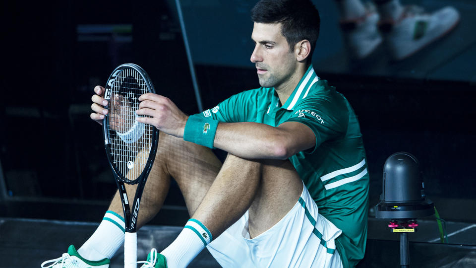 Novak Djokovic, pictured here sitting at the back of the court between games.