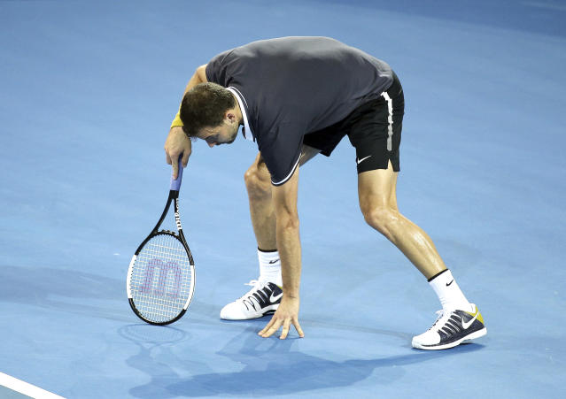 Grigor Dimitrov of Bulgaria reacts after missing a shot during his quarterfinal match against Kei Nishikori of Japan at the Brisbane International tennis tournament in Brisbane, Australia, Thursday, Jan. 3, 2019. (AP Photo/Tertius Pickard)