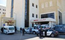 Police officers stand outside the new Salt government hospital in the city of Salt