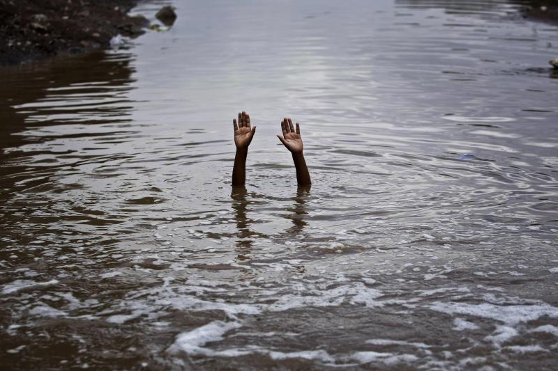 Bsam Ali, 11, swims in polluted water at a slum area on the outskirts of Sanaa, Yemen, Monday, April 22, 2013. Hundreds of countries globally, mark International Earth Day on April 22, to help raise ecological awareness and support environmental protection. (AP Photo/Hani Mohammed)