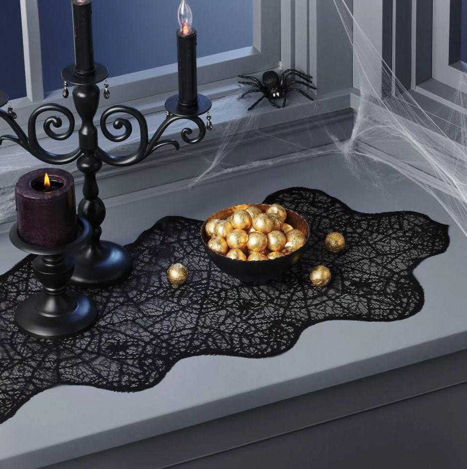 "Be on the lookout for any actual spiders. <a href=""https://goto.target.com/c/2055067/81938/2092?u=https%3A%2F%2Fwww.target.com%2Fp%2Flace-web-halloween-table-runner-hyde-38-eek-boutique-8482%2F-%2FA-78638822%3Fref%3Dtgt_adv_XS000000%26AFID%3Dgoogle_pla_df%26fndsrc%3Dtgtao%26DFA%3D71700000012806747%26CPNG%3DPLA_Seasonal%252BShopping_Local%26adgroup%3DSC_Seasonal%26LID%3D700000001170770pgs%26LNM%3DPRODUCT_GROUP%26network%3Dg%26device%3Dc%26location%3D9004054%26targetid%3Dpla-956047986400%26ds_rl%3D1246978%26ds_rl%3D1248099%26ds_rl%3D1247068%26gclid%3DCjwKCAjwiaX8BRBZEiwAQQxGx7leEBQXpieNm0wNQjBe93CkD8gOuHAGUaoSDnMnWhCKWTW9QNn4SRoCqoUQAvD_BwE%26gclsrc%3Daw.ds&subid1=5&subid2=halloween&subid3=decor"" target=""_blank"" rel=""noopener noreferrer"">Find it for $10 at Target</a>."