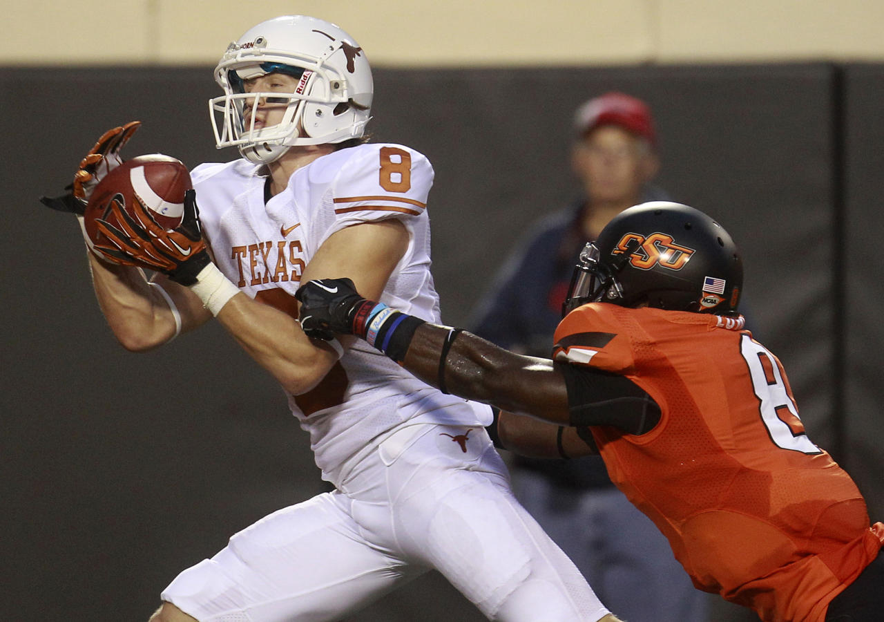 Texas wide receiver Jaxon Shipley (8) catches a touchdown pass in front of Oklahoma State safety Daytawion Lowe (8) during the first quarter of an NCAA college football game in Stillwater, Okla., Saturday, Sept. 29, 2012. (AP Photo/Sue Ogrocki)