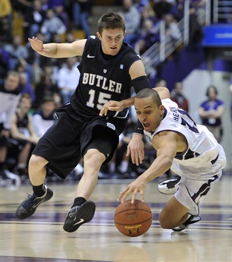 Butler's Rotnei Clarke (15) and Northwestern's Reggie Hearn scramble for a loose ball during the second half of an NCAA college basketball game Saturday, Dec. 8, 2012, in Evanston, Ill. Butler defeated Northwestern 74-65. (AP Photo/Jim Prisching)