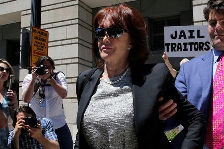 Kathleen Manafort, wife of former Trump's campaign manager Paul Manafort, departs without him after his arraignment on a third superseding indictment against him by Special Counsel Robert Mueller on charges of witness tampering, at U.S. District Court in Washington, U.S., June 15, 2018. REUTERS/Jonathan Ernst