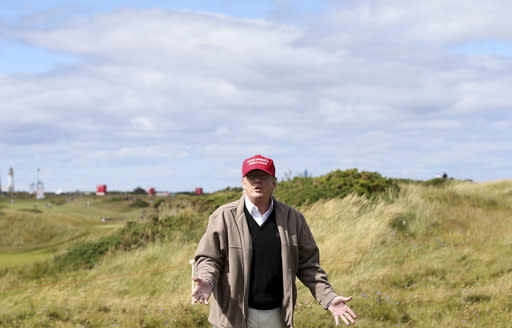 "FILE - In this Thursday, July 30, 2015 file photo, Presidential contender Donald Trump gestures to the media on the 17th fairway on the first day of the Women's British Open golf championship on the Turnberry golf course in Turnberry, Scotland. The chief executive of the R&A says on Monday, Jan. 11, 2021 Donald Trumps ownership of Turnberry will prevent the Scottish course from staging the British Open for ""the foreseeable future."" Turnberry hasnt hosted the tournament since it was bought by Trump in 2014. (AP Photo/Scott Heppell, file)"