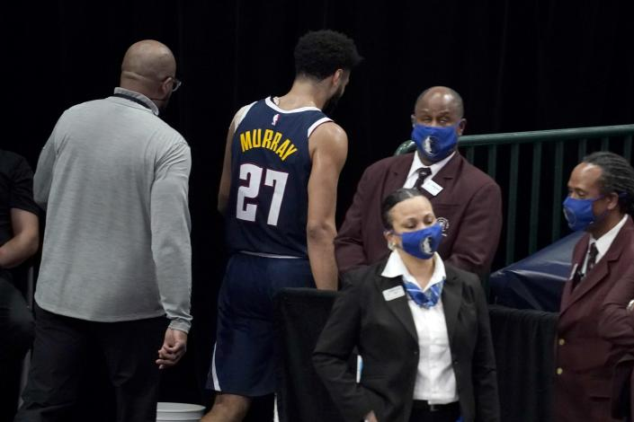 Denver Nuggets guard Jamal Murray (27) leaves the court after being ejected in the second half of an NBA basketball game against the Dallas Mavericks in Dallas, Monday, Jan. 25, 2021. (AP Photo/Tony Gutierrez)
