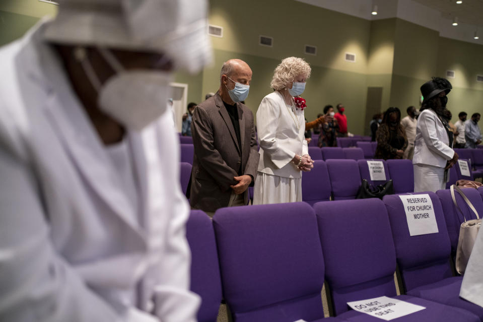 People wear face masks at the New Horizon International Church, Sunday, Oct. 4, 2020, in Jackson, Miss. In the wake of the coronavirus pandemic, there are carefully enforced mask mandates, multiple disinfectant stations, parishioners who sit 2 or 3 pews apart, cameras to broadcast sermons to people who want to stay at home and pastors who don't let anyone forget the disease is serious. (AP Photo/Wong Maye-E)