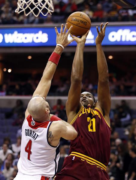 Cleveland Cavaliers center Andrew Bynum (21) shoots over Washington Wizards center Marcin Gortat (4), from Poland, in the first half of an NBA basketball game on Saturday, Nov. 16, 2013, in Washington. (AP Photo/Alex Brandon)