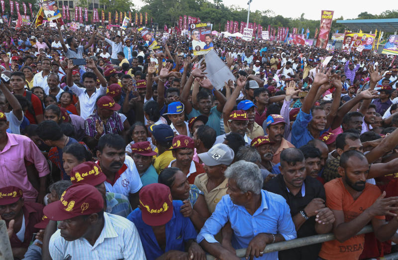 Supporters listen to Sri Lankan presidential candidate and former defense chief Gotabaya Rajapaksa during his maiden election campaign rally in Anuradhapura, Sri Lanka, Wednesday, Oct. 9, 2019.Sri Lanka's president will stay neutral in the upcoming presidential election but his party will back a breakaway party candidate, front-runner Gotabaya Rajapaksa, officials said Wednesday. ( AP Photo/Sajeewa Chinthaka)