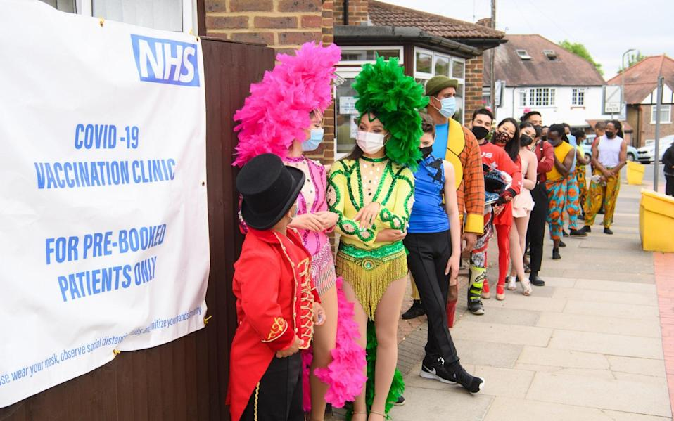 Zippos circus performers await their Covid vaccinations in Finchley, north London, under the Vaxi Taxi project to get jabs to those who may fall through the cracks of the regular rollout - Matt Crossick/Empics