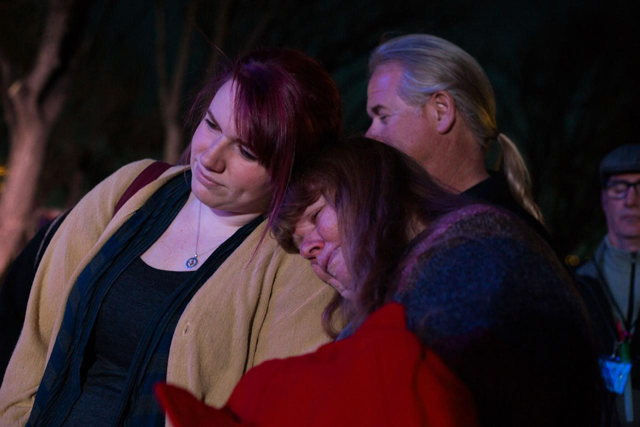 Kayla Jean Mueller, an American woman held by Islamic State militants, has been confirmed deadPeople attend a candlelight memorial honoring Kayla Mueller at the Prescott's Courthouse Square in Prescott, Arizona