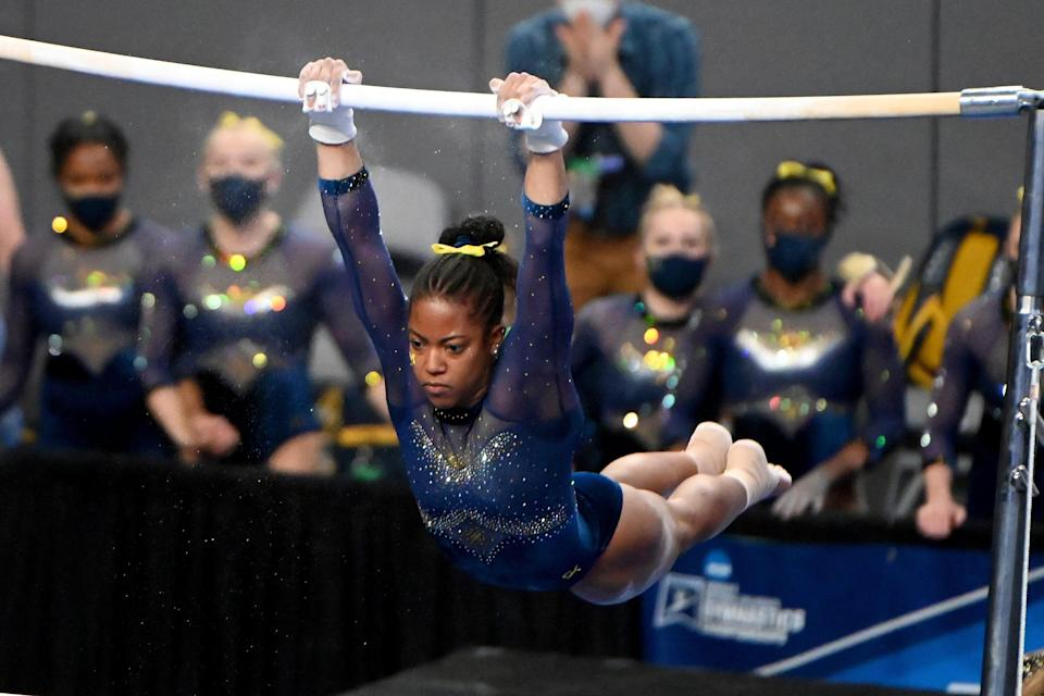 Michigan's Sierra Brooks performs on the uneven bars during the NCAA championships in Fort Worth, Texas, on Saturday, April 17, 2021.