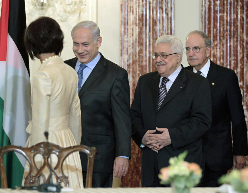 FILE - In this Thursday, Sept. 2, 2010, file photo, Israeli Prime Minister Benjamin Netanyahu, 2nd left, and Palestinian President Mahmoud Abbas, 2nd right, are escorted to their seats by Special Envoy George Mitchell, right, at the opening session of face-to-face peace talks hosted by the U.S., at the State Department in Washington. The question of whether mediators matter took on an acuity Monday May 16, 2011, following the resignation of U.S. Mideast envoy George Mitchell, a move that came exactly as the Israeli-Palestinian conflict he was asked to help resolve seems about to retake center stage. (AP Photo/J. Scott Applewhite, File)