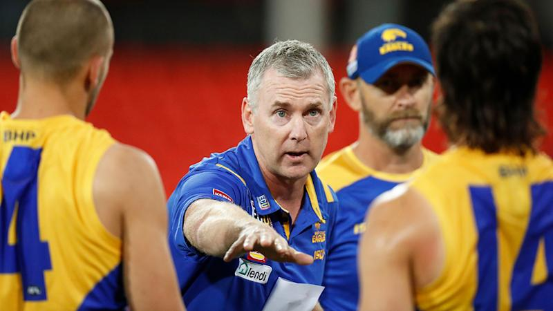 Pictured here, West Coast coach Adam Simpson addresses his players during an AFL match.