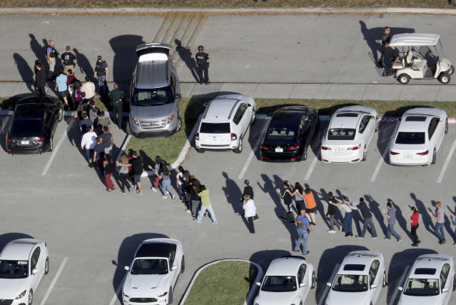 Students are evacuated by police out of Marjorie Stoneman Douglas High School in Parkland, Fla. Photo: Mike Stocker/South Florida Sun Sentinel